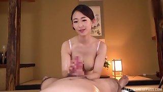 Seductive POV handjob with a busty Asian milf addicted to cock