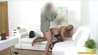 Fake-chested MILF shows up to an agent's office desiring to wow him
