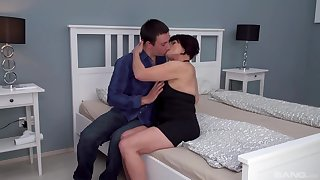 Dark-haired mature slut Attilane beds a much younger man
