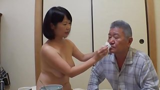 Japan mature stands nude and pleases her man the right akin to