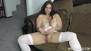 Curvy stunner stands nude and masturbates